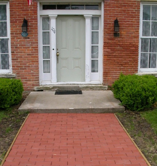 (front door and brick sidewalk of the Adlai Stevenson I house)